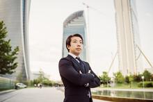 Portrait Of Asian Businessman Wearing Dark Suit.