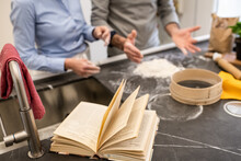 Couple Standing In A Kitchen, Making Fresh Homemade Pasta.