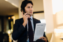 Businessman Ordering Room Service In Hotel