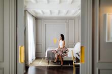 Fashionable Woman Beside Window In Suite