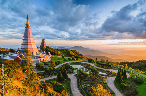 Fototapeta Landscape of two pagoda in Doi Inthanon Mountain with evening orange light splas