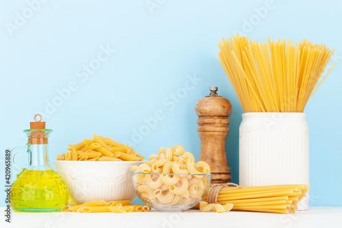 Fototapeta Various types of Italian pasta and olive oil obraz