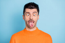 Photo Of Young Brown Hair Man Fooling Grimacing Joke Humor Comic Tongue-out Isolated Over Blue Color Background