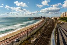 Industrial Area In Tarragona; Railway Tracks Along A Beach