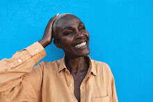 Happy African Woman Portrait - Afro Senior Female Having Fun While Standing On Blue Background