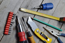 Some Home Repair Tools Lie On A Wooden Background. Close-up.