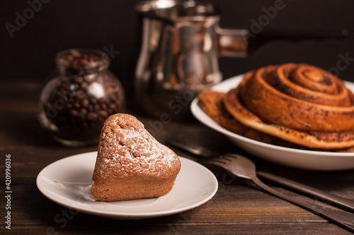 Fototapeta sweets on the table cookies gingerbread cookies a cup of coffee dessert obraz