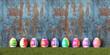 canvas print picture - Ostereier mit Wasserfarben bemalt zu Ostern vor Holz