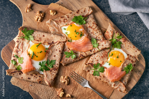 Canvas Crepes with eggs, salmon, spinach and nuts