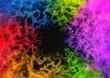 カラフルな粒子が渦巻く抽象的な背景