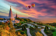 Colorful Hot Air Balloons Flying Over Two Pagoda In Doi Inthanon Mountain In Chiang Mai, Thailand, Hot Air Balloon Above High Mountain At Sunset