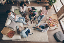 Top Above High Angle View Of Attractive Cheerful Friends Eating Snack Gathering Playing Guitar Having Fun In House Loft Brick Style Interior Indoors