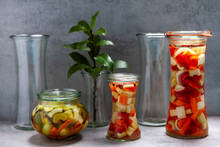 Glass Jars Of Various Shapes With Vegetable Pickles. Homemade Food Preserved. Few Empty Jars.