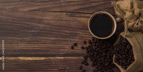Fototapeta Love drinking coffee, coffee mugs and coffee beans on the table obraz