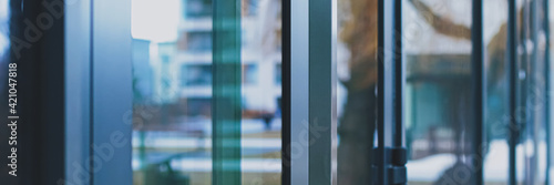 Fototapeta Glass walls as abstract urban background, exterior design and architectural deta