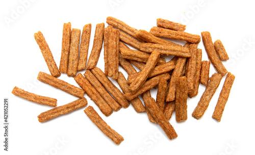 Fototapeta long sticks of bread croutons on a white background obraz