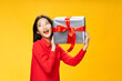 Happy woman with gifts in her hands laughs