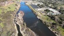 Aerial Footage Of The Nimbus Fish Hatchery And Nimbus Dam On The American River Near Folsom, California. Flying Towards Lake Natoma