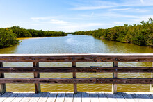 Sanibel Island, USA Bowman's Beach With Landscape View Of Bayou From Wooden Boardwalk Bridge With Railing On River Bay In Summer