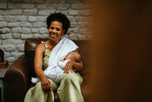 Smiling Woman Breastfeeding Her Baby