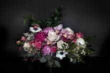 White, Pink, And Purple Flower Bouquet In A Dark Background