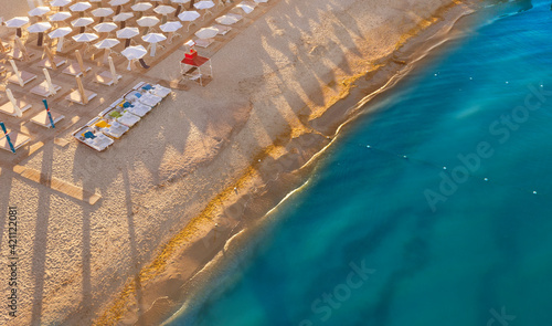 Obraz Empty beach top view. The concept of a bad tourist season. - fototapety do salonu