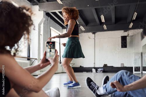 Funny pretty woman showing new dance in studio