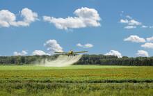 Crop Duster Spraying A Farm Field Pesticide.