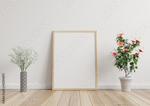 Fototapeta Mock up photo frame in the room, white wall on the wooden floor, beautiful pattern, decorated with plants on the side.3d rendering. obraz
