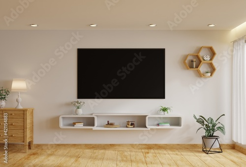 Fototapeta TV in the living room on a white wall by the window, decorated with plants, vases, flowers, toys and lamps.3d rendering. obraz