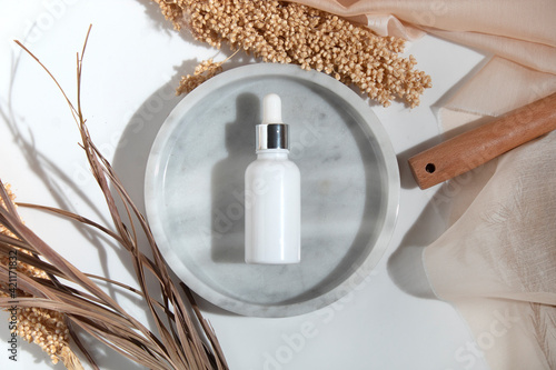 Obraz mockup of beauty fashion cosmetic makeup bottle serum dropper product with skincare healthcare concept on background - fototapety do salonu