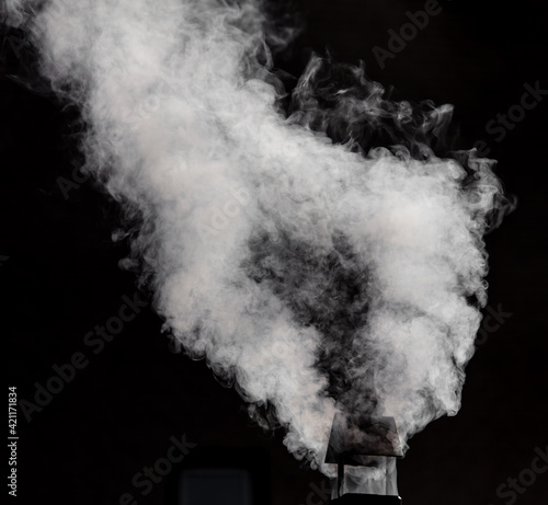Foto White smoke from the chimney. Background