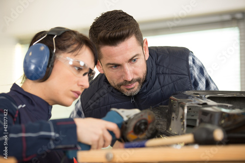 Fotografie, Obraz woman works on a metal part