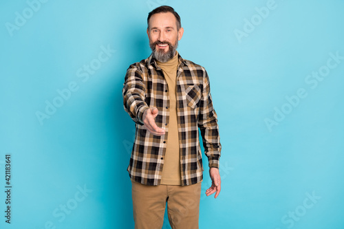Fototapeta Photo portrait of aged man inviting laughing greeting nice to meet you isolated on bright blue color background obraz