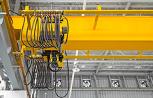 Overhead Crane Inside Factory Or Warehouse. That Industrial Machinery Or Lifting Equipment Consist Of Hoist, Hook And Wire Rope Traveling On Beam Girder Structure. For Manufacturing Production Plant.
