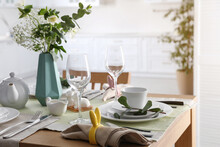 Beautiful Easter Table Setting With Festive Decor Indoors