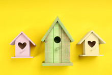 Beautiful Bird Houses On Yellow Background, Flat Lay