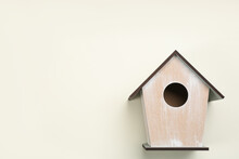 Beautiful Bird House On Beige Background, Top View. Space For Text