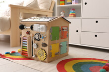 Busy Board House On Floor Indoors. Baby Sensory Toy