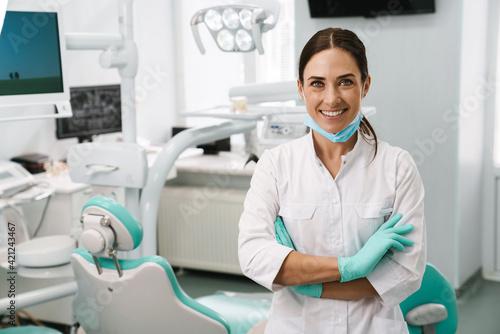 Fototapeta European mid dentist woman smiling while standing in dental clinic obraz