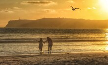 Silhouette Of Couple Standing On Beach