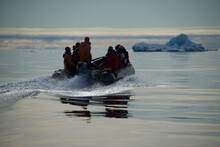 People In Lifeboat On Sea During Winter
