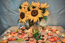 Close-up Of Sunflowers In Vase On Table