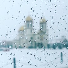 Full Frame Shot Of Raindrops On Glass Window. Greek Orthodox Church