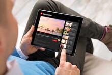 Man Watching Online Videos On Tablet
