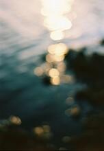 Defocused Sunlight Falling On Sea