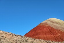 Low Angle Landscape Of Barren Orange And Tan Hillside At The Painted Hills In Oregon