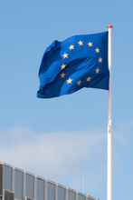 Low Angle View Of European Union Flag Against Blue Sky