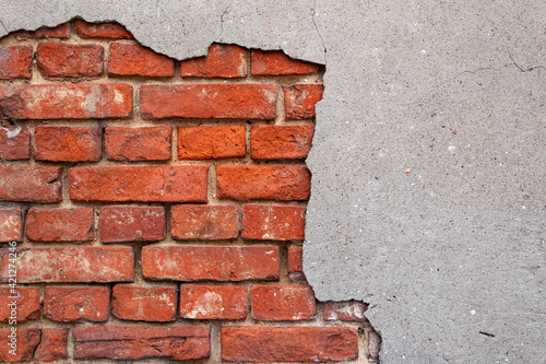 Broken wall with red bricks in close-up, gray-red background, texture Fototapete