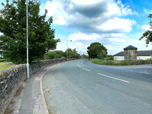 View Along, Westfield Lane, With Stone Walls, Fields, And A Cloudy Sky In, Bradford, Yorkshire, UK